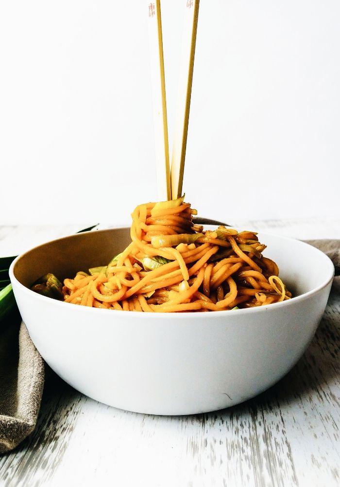 chop sticks with stir fried noodles