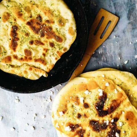 Buttermilk Naan bread fried in Ghee and seasoned