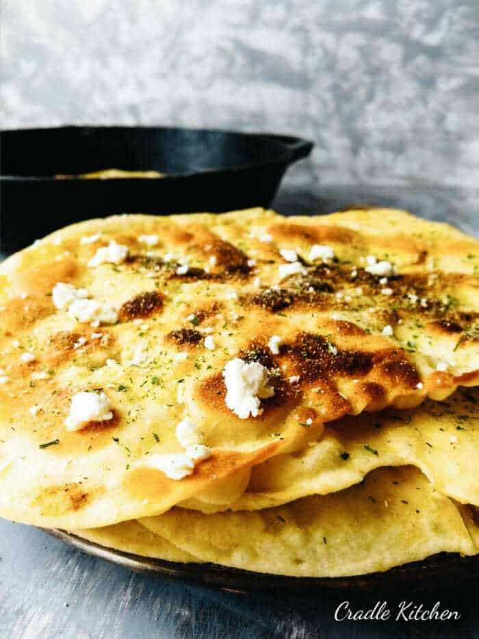 stacked buttermilk naan bread with onion salt and feta cheese