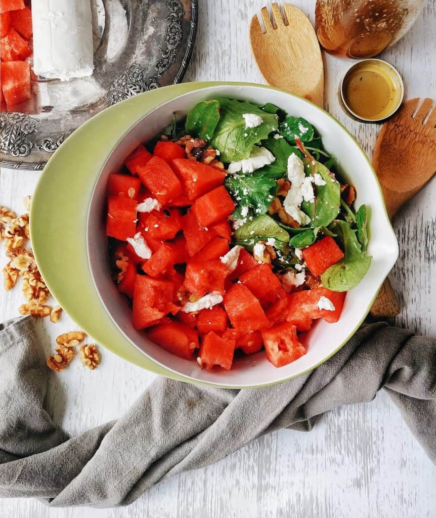 watermelon goat cheese and walnuts in a salad bowl