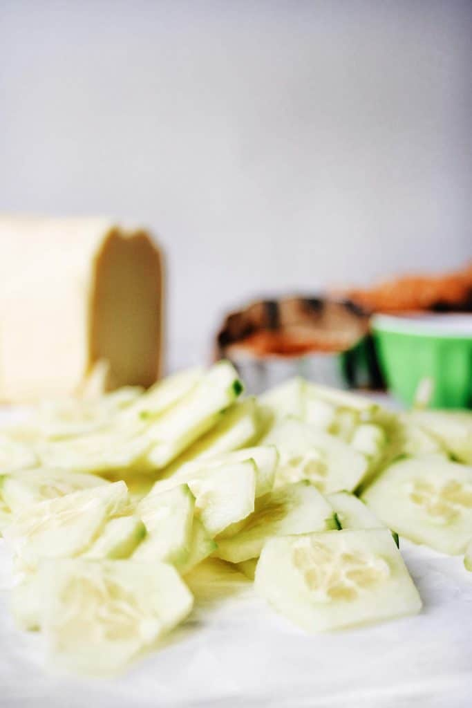 thinly sliced cucumbers with butter and bread