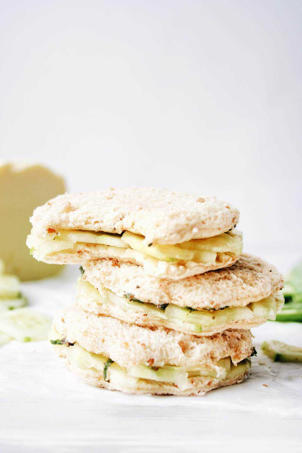 stacked cucumber sandwiches with a bite in one