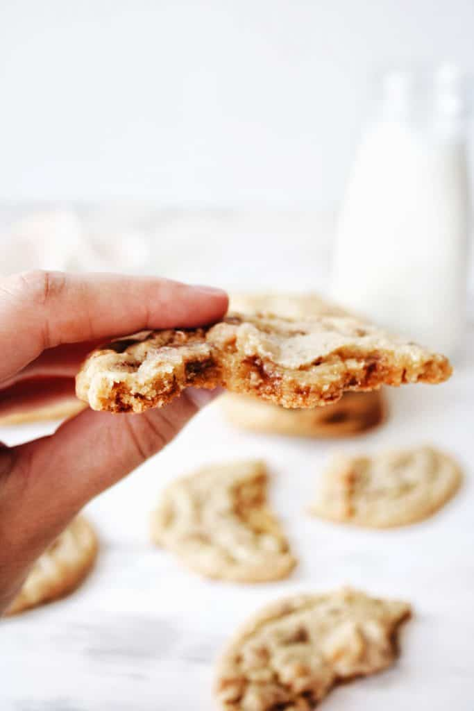 hand holding half eaten cookie showing the texture