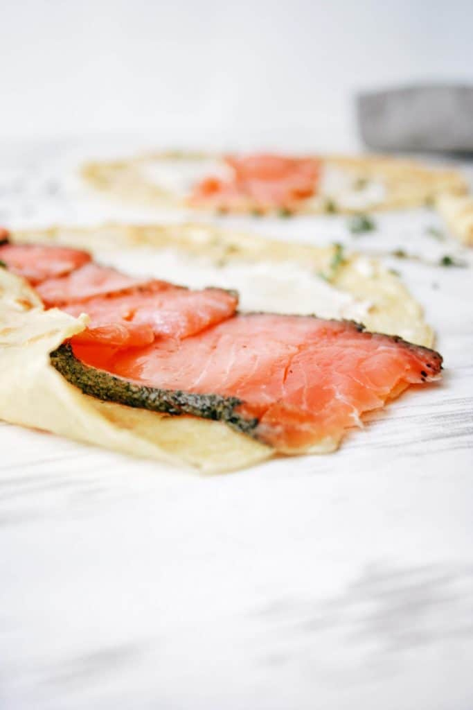close up of smoked salmon in a crepe with cream cheese
