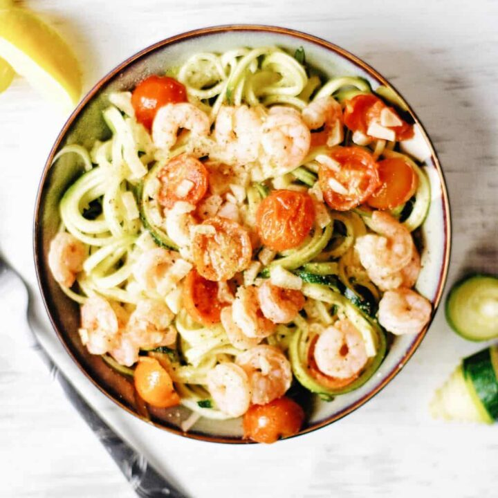 bowl of zucchini noodles with shrimp and tomatoes