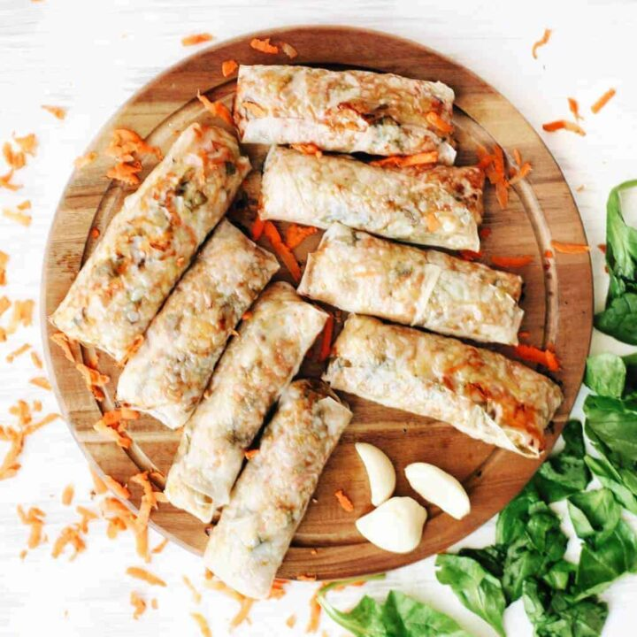 platter of baked spring rolls with spinach and shredded carrots