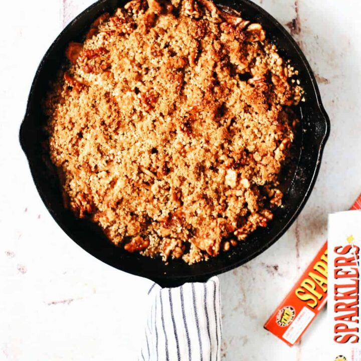 cast iron skillet full of apple crumble