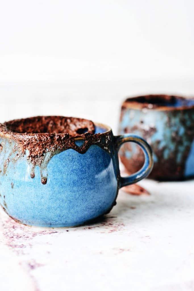 2 blue mugs filled with chocolate mug cake