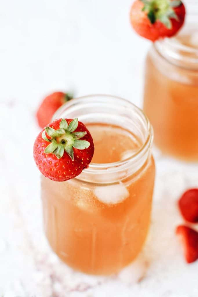 Close up of green iced tea with strawberries