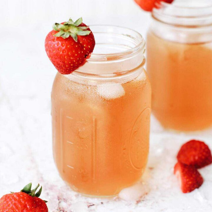 sweet green iced tea with strawberries and crushed ice