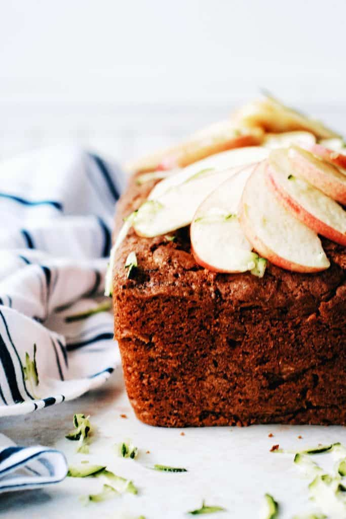 Front of the loaf of apple zucchini bread with apple slices on top