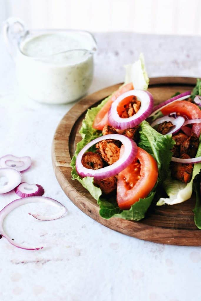 red onion and tomatoes topping lettuce wraps