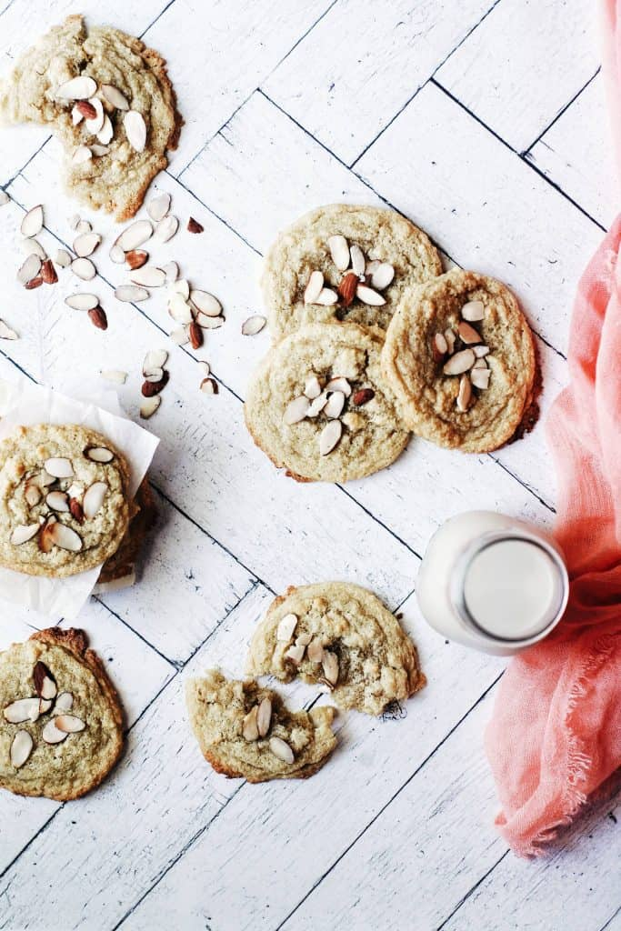 spread of gluten free almond cookies and a glass of milk