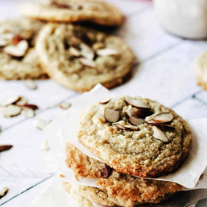 stack of almond cookies with slivered almonds on top