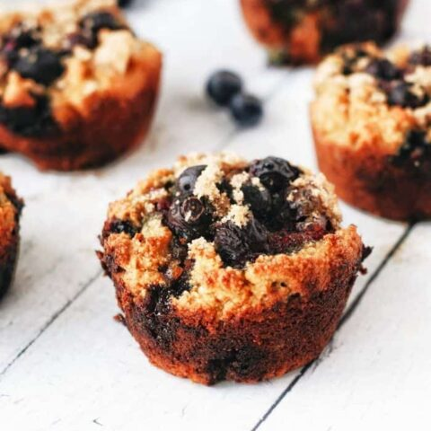 a blueberry sweet potato muffin with brown sugar on top