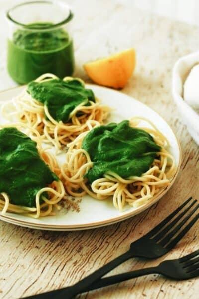 plate full of spaghetti and spinach pesto