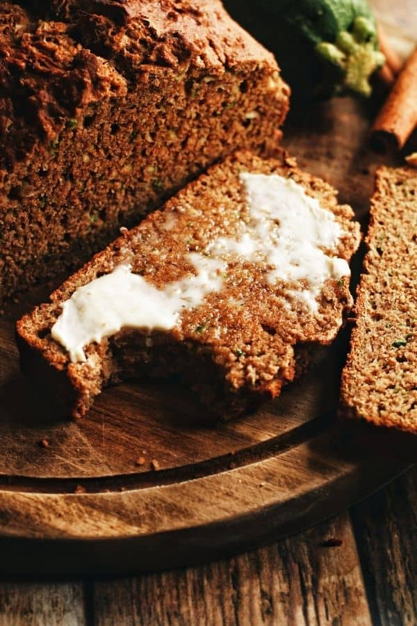 a slice of whole wheat zucchini bread with butter