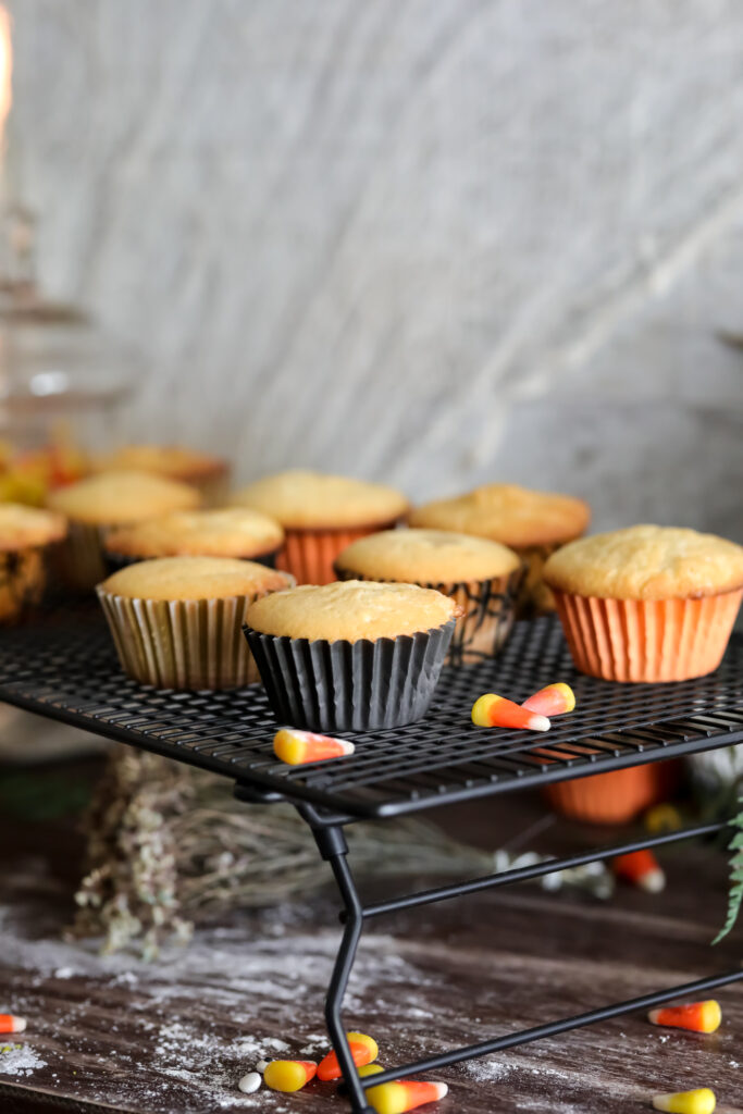 cooked cupcakes on a cooling wrack with candy corn