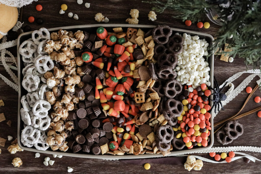 rows of trail mix ingredients on a cookie sheet