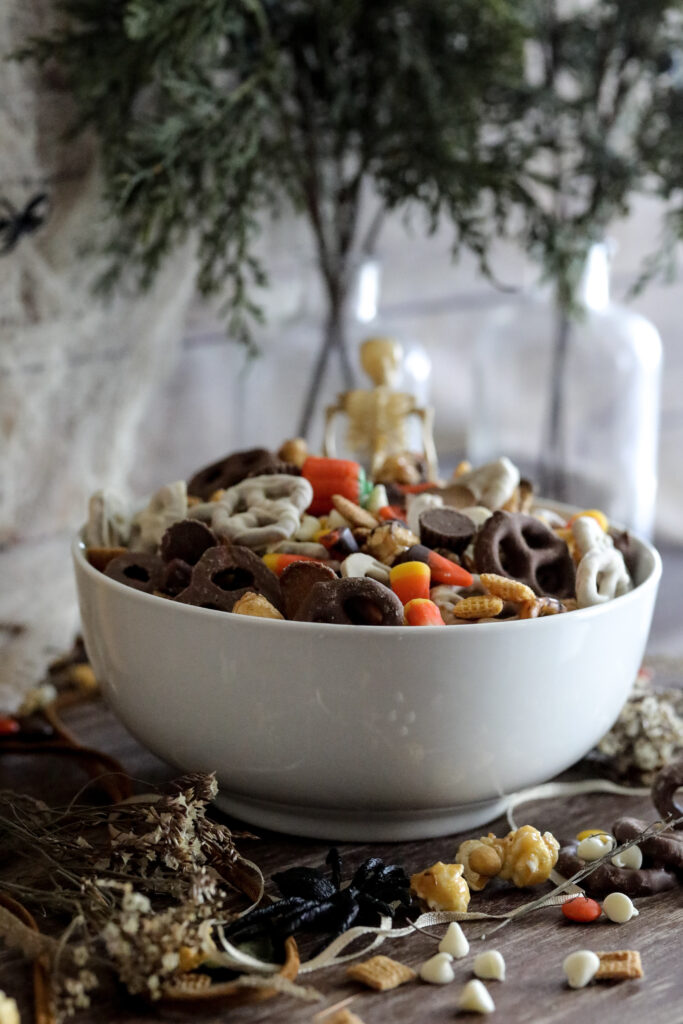 the ultimate halloween trail mix in a white bowl on a table